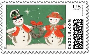 Red hat snow woman and snowman present a Christmas wreath in this <i>vintage snowman stamp</i>