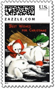 A vintage snow boy and snow girl have a tumble on their sled. Text on this <i>snowman stamp</i>: Best Wishes For Christmas.