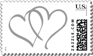 Two stylized and interlocking silver hearts against a white background make this a chic and simple wedding stamp for all your wedding mailings.